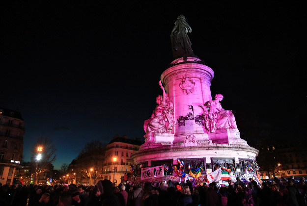 The Place de la Republique is lighted in red after a commemoration ceremony to mark the one-year anniversary of the Charlie Hebdo and Hypercacher supermarket terror attacks, in Paris, Sunday, Jan. 10, 2016. French President Francois Hollande and other dignitaries held a special ceremony Sunday to honor all those killed in Islamic extremist violence around Paris in 2015 a year when the European way of life was targeted time and again with deadly consequences.