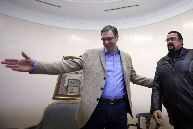 Serbian Prime Minister Aleksandar Vucic, left, welcomes Hollywood actor and producer Steven Seagal, in Belgrade, Serbia, Tuesday, Jan. 12, 2015. Serbia has granted citizenship to Seagal on Monday.