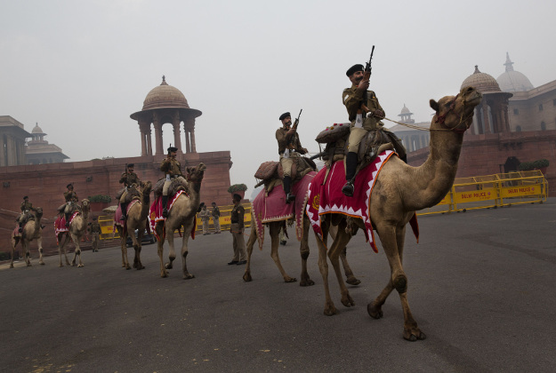 Camel mounted Border Security Force soldiers prepare to march during rehearsals for the upcoming Republic Day parade, near the Presidential Palace in New Delhi, India, Wednesday, Jan. 13, 2016. Indian marks Republic Day on Jan. 26.