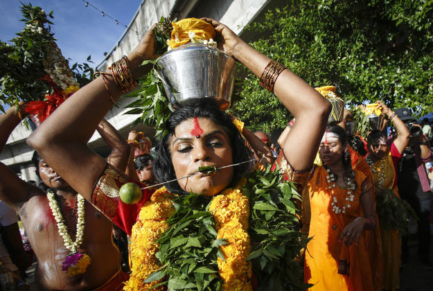 Hindu devotees carry milk pots on their heads while participating in a procession during the Thaipusam festival in Kuala Lumpur, Malaysia, Sunday, Jan. 24, 2016. Thaipusam, which is celebrated in honor of Hindu god Lord Murugan, is an annual procession by Hindu devotees seeking blessings, fulfilling vows and offering thanks.