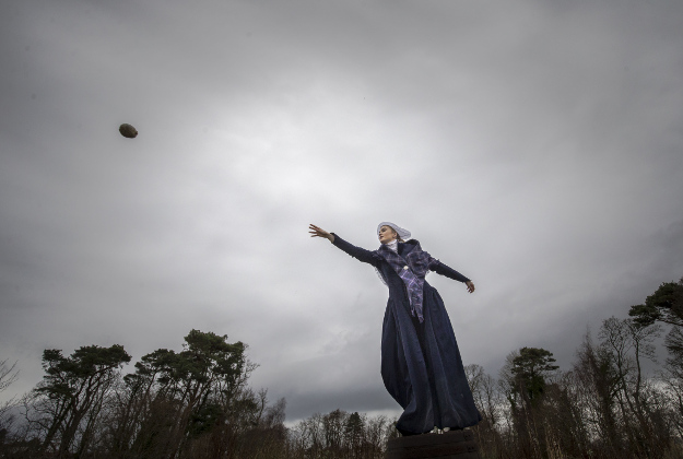 Rebekah McGinn, dressed in a late 18th century costume, takes part in the 1759 World Haggis Hurling Championship 2015 at Burns Cottage in Alloway, Scotland, where Scottish poet Robert Burns was born, ahead of the Burns Night celebrations.