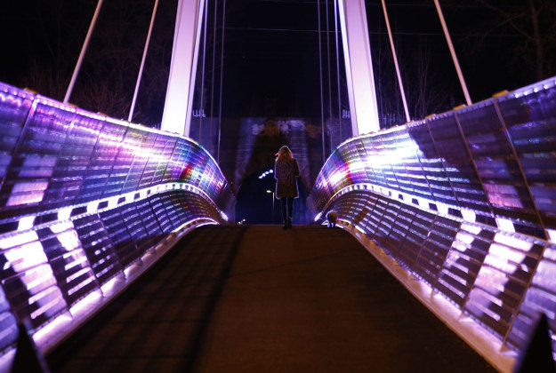 A lady walks her dog over the newly erected foot bridge over the M62 in Liverpool.