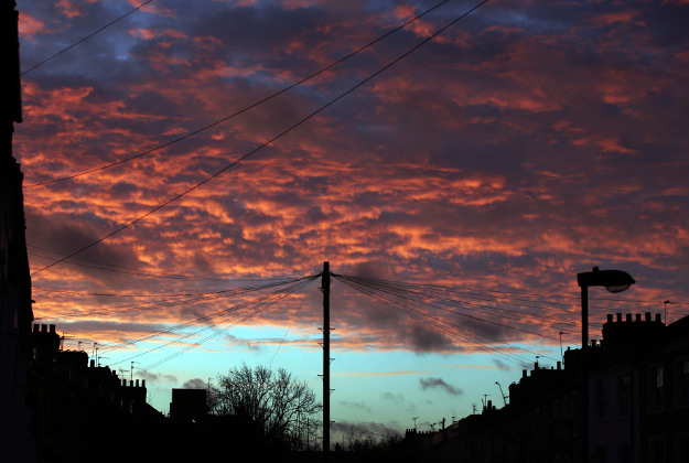 Sunrise in north London as huge swathes of the UK are braced for a deluge of rain which could pour more misery on communities still reeling from flooding after Christmas. The remnants of storm Jonas, which blanketed much of the east coast of America in deep snow, have begun to sweep in from the Atlantic, prompting widespread weather and flood alerts.