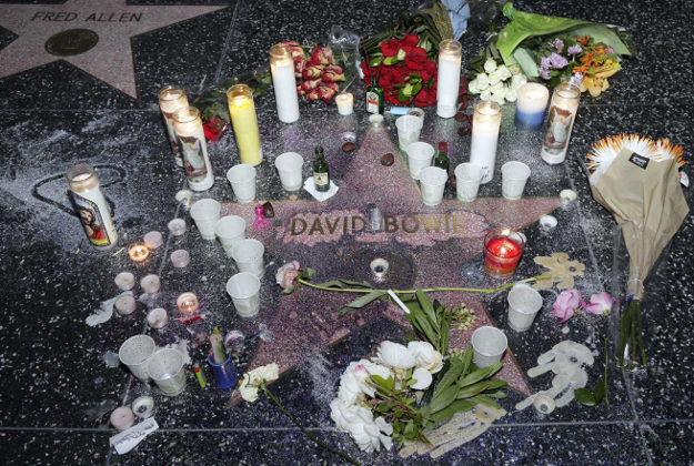 A makeshift memorial surrounds David Bowie's star on the Hollywood Walk of Fame in Los Angeles, Monday.