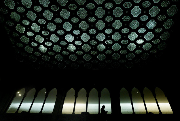A person is silhouetted in the foyer of the House of Commons on Parliament Hill in Ottawa, Ontario, on Tuesday, Jan. 26, 2016.