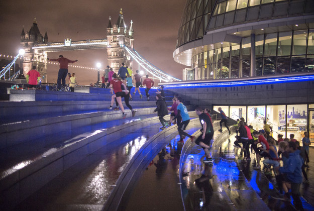 Participants exercise during a Project Awesome exercise session at the Scoop, City Hall, London. Project Awesome is a free fitness movement in London and uses a simple sense of accountability to motivate and encourage people of all ages, shapes, sizes and fitness levels to exercise at the Scoop and Primrose Hill.