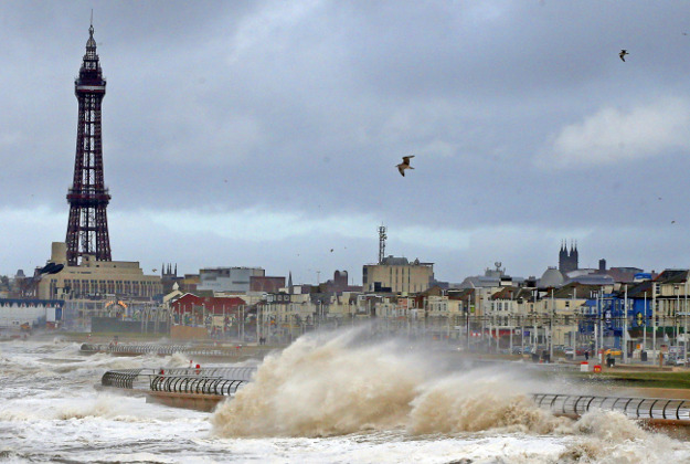 Huge waves crash over the sea walls at Blackpool, Lancashire, as the tail end of the US Storm Jonas continued to sweep in from the Atlantic.