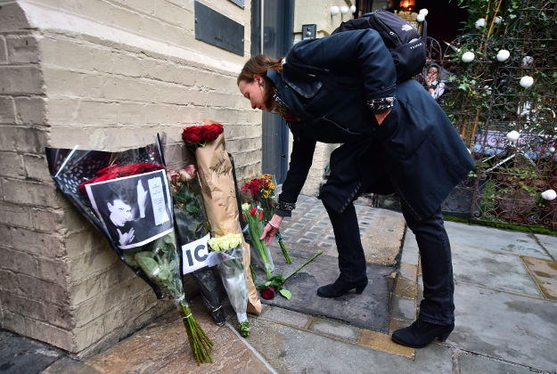 9.A woman lays flowers underneath a commemorative plaque to David Bowie's iconic creation, Ziggy Stardust, in Heddon Street, London, marking the 40th anniversary of the album, The Rise and Fall of Ziggy Stardust and The Spiders from Mars.