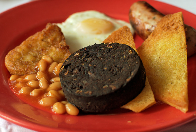 Black pudding on a breakfast plate.