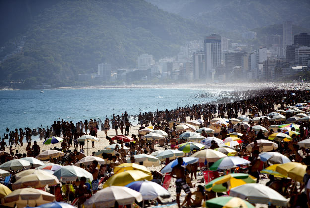 Weekend crowds gather on Ipanema Beach.