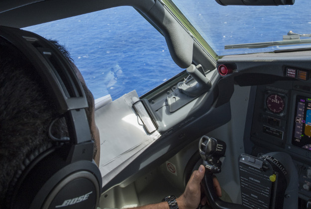 An air-born search time looking for missing MH370 plane.