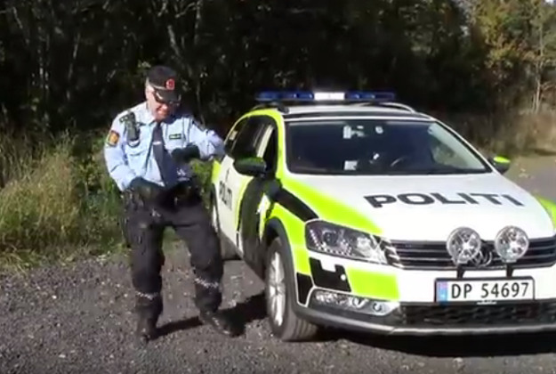 Busting a move beside his cop car. Image by Screengrab via YouTube