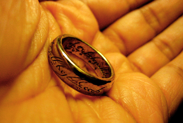 The 'one ring' from the Lord of the Rings embossed with elvish script.