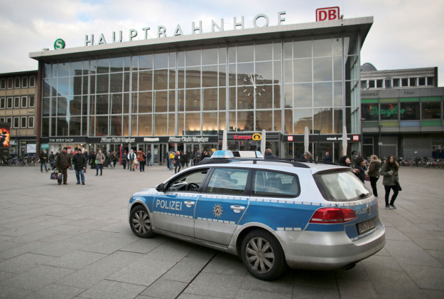 A police car passes the central railway station in Cologne