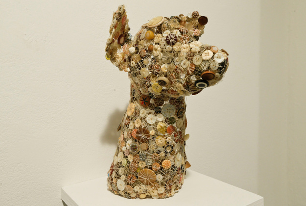 The bust of a dog from New York's button art exhibition