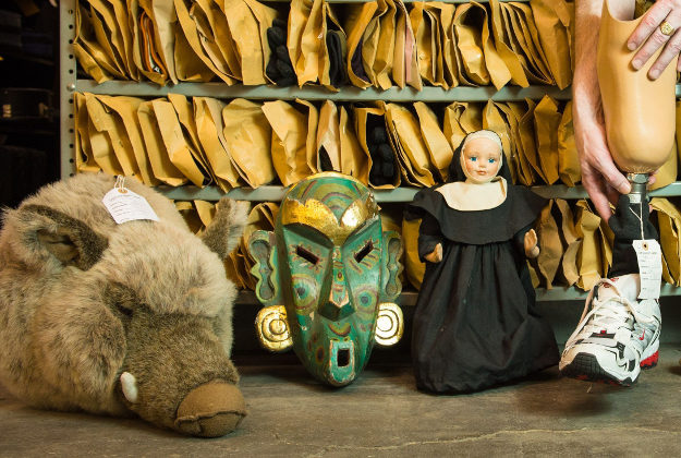 A soft toy boar's head, a carved wooden mask, a nun doll and a prosthetic leg are among the items at the Transport for London Lost Property Office.