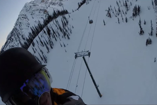 A snowboarder who was trapped on a broken gondola filmed his helicopter rescue.