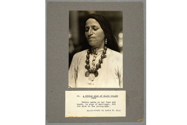 Caption: A Syrian Arab at Ellis Island - 1926. Tattoo marks on her face and hands, (a sign of marriage), did not show in the photograph.