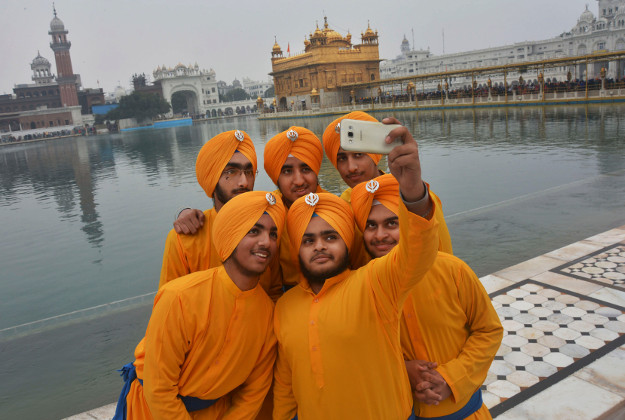 Sikh devotees take a selfie in Amritsar, India