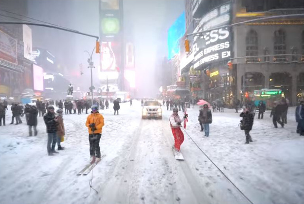 A snowboarder took to New York's closed down streets in the middle of a large snow storm.