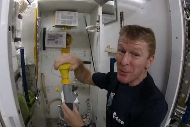 Astronaut Tim Peake show people how to use the loo in space.