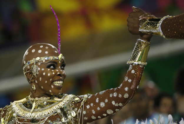Performer from the Mangueira samba school parades during carnival celebrations at the Sambadrome in Rio de Janeiro, Brazil, Tuesday, Feb. 9, 2016.