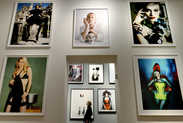 A woman views a selection of photographs.