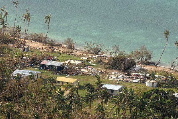 In this Sunday, Feb. 21, 2016 aerial photo supplied by the New Zealand Defense Force, debris is scattered around damaged buildings at Susui village in Fiji, after Cyclone Winston tore through the island nation. Fijians were finally able to venture outside Monday after authorities lifted a curfew but much of the country remained without electricity in the wake of a ferocious cyclone that left at least six people dead and destroyed hundreds of homes.
