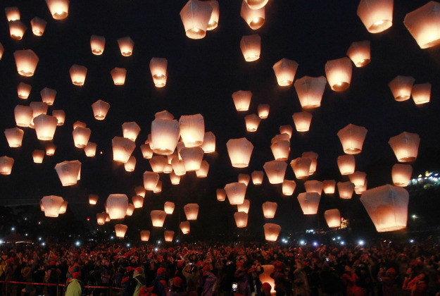 Hundreds of people release lanterns into the air in hopes of good fortune and prosperity at the traditional lantern festival during the Chinese New Year in the Pingxi district of New Taipei City, Taiwan, Monday, Feb. 22, 2016. The lantern festival starts 15 days after the Chinese Lunar New Year and falls on Feb. 22, this year.