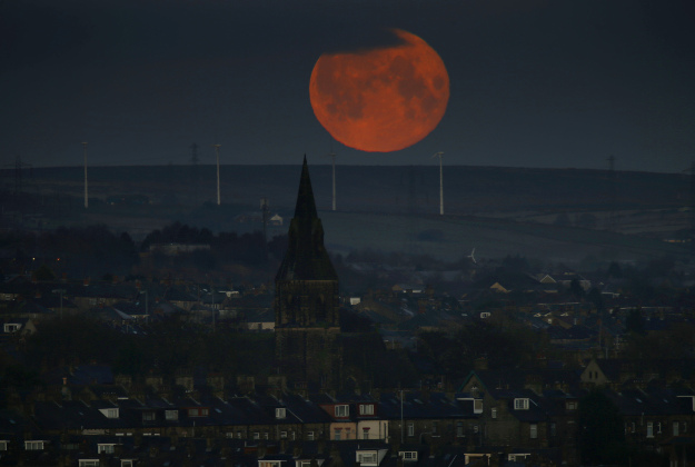A full moon sets over Bradford, West Yorkshire.