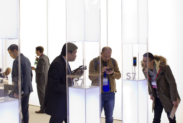 Men look at the new Galaxy S7 phone at the Mobile World Congress wireless show, in Barcelona, Spain, Tuesday, Feb. 23, 2016.