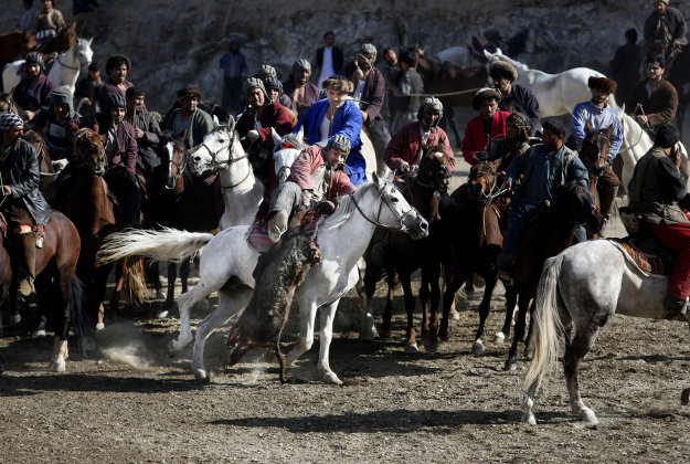Afghan horse riders compete for the goat during a friendly buzkashi match on the outskirts of Kabul, Afghanistan, Thursday, Feb. 25, 2016. Buzkashi is a traditional and the national sport of Afghanistan, where players compete to place a goat carcass into a goal circle. It was banned during the Taliban rule.