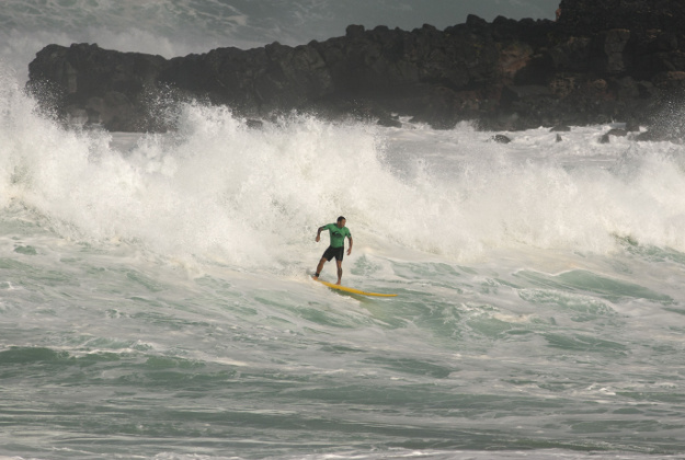 Sunny Garcia, of Hawaii, rides a wave to shore during the Eddie Aikau big-wave surfing contest in Waimea Bay near Haliewa, Hawaii on Thursday, February 25, 2016. After days of massive waves in Hawaii, some reaching over 50 feet high and washing over roads and homes, organizers gave the nod Thursday morning to hold the rare big-wave surfing competition. Organizers of invitation-only Quiksilver In Memory of Eddie Aikau contest on Oahu's North Shore said the waves met the requirements of being at least 40-feet tall with sustained swells that lasted long enough to run multiple heats.