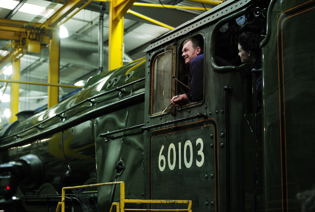 Heritage painter Mike O'Connor paints in the engine number onto the new Green livery on the Flying Scotsman in the workshops at the National Railway Museum in York. Image by: John Giles/PA Wire.