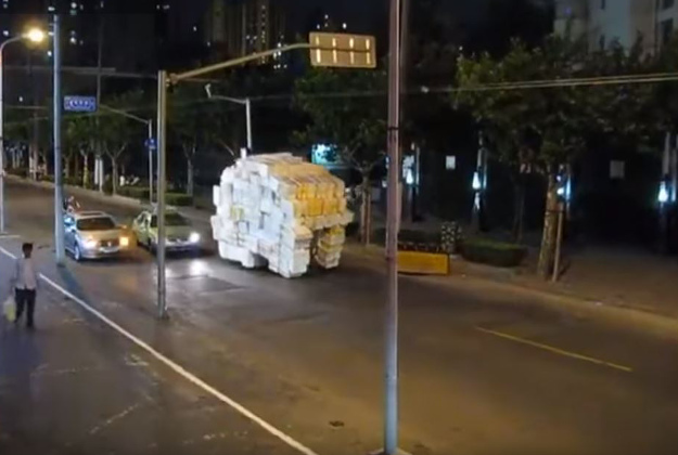 The hilariously overloaded tricycle in Shanghai