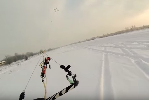 Kaspars Balamovskis being pulled along by the drone. Image by Screengrab via YouTube