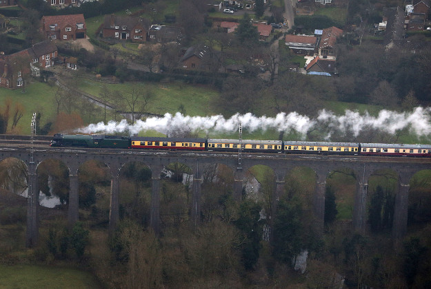 An aerial view of the Flying Scotsman going over the Digswell Viaduct near Welwyn Garden City on its inaugural run from London to York after a decade long, £4.2 million refit.