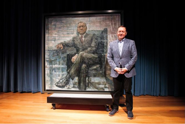 Kevin Spacey stands in front of his portrait  as Frank Underwood