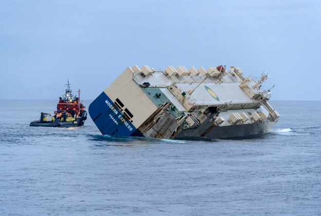 """""""Modern Express"""" is towed as it drifts off the coast of France"""