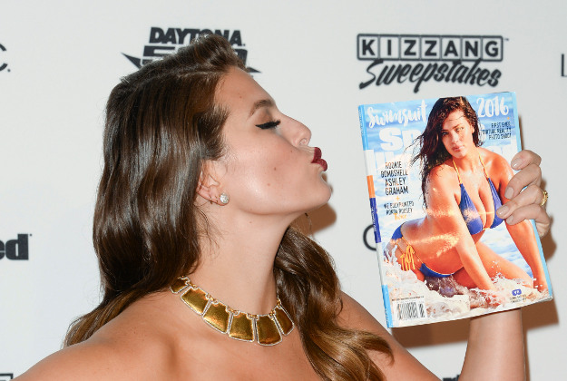 Model Ashley Graham holding her copy of Sports Illustrated