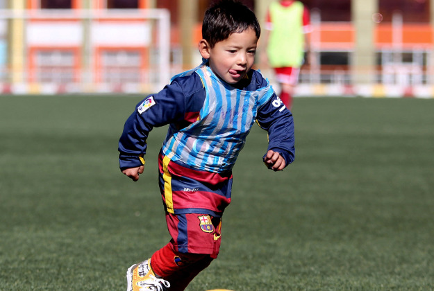 Martaza Ahmadi, a five-year-old Afghan Lionel Messi fan with his homemade strip.