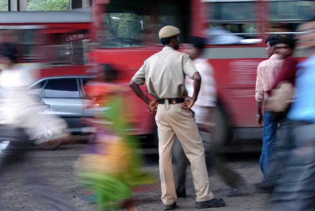 Indian police guide traffic in Mumbai.