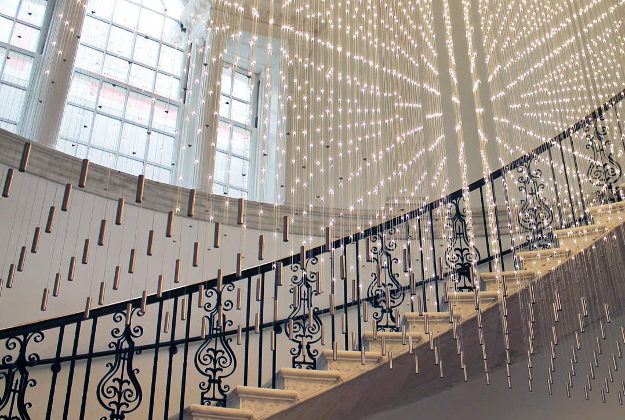 """newmuseumInstalled in the @museumofcityny lobby, """"Starlight (Hanging Grid II)"""" is a dazzling light installation, designed by Cooper Joseph Studio. Shaped in dialogue with the design of the building's historic stairway, the piece is a poignant reminder of how architecture can reflect and further the mission of a Museum--in this case to connect the city's past and present. Similarly, the New Museum's building was designed in response to the history and powerful personalities of both the institution and its storied site on the Bowery. #MuseumInstaSwap"""