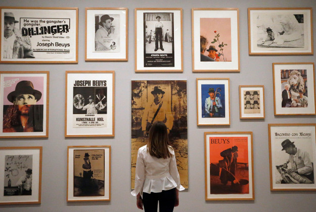 A woman admires a photo of Joseph Beuys as part of the Tate Modern's latest exhibit