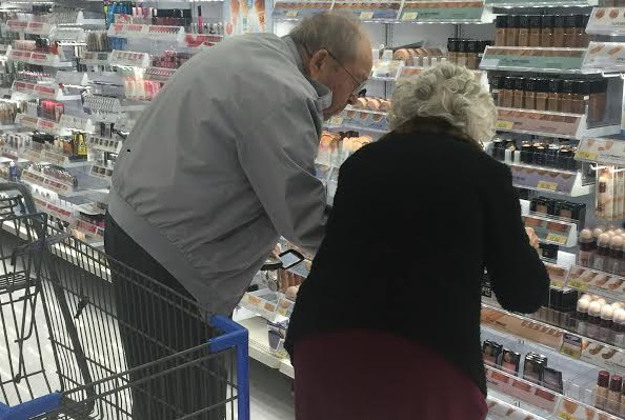An elderly man helps his wife pick out makeup and the image went viral
