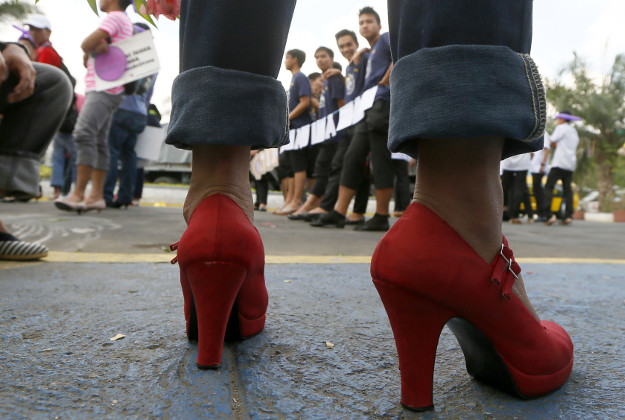 Male students and soldiers wearing high-heeled shoes march around a park to pay tribute to women all over the world on the eve of the celebration of International Women's Day Monday, March 7, 2016 at suburban Quezon city, northeast of Manila, Philippines. The all male marchers are calling for gender equality and an end to all forms of discrimination and harassment against women.