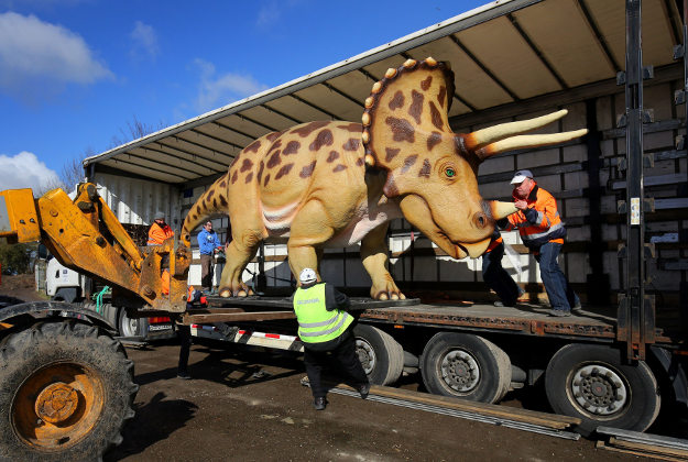 A lorry of dinosaurs is unloaded at Port Lympne Wild Animal Park near Ashford, Kent, as the final shipment arrives from Germany to be placed in the park as a permanent display featuring 103 anatomically correct replica dinosaurs opening this Easter. PRESS ASSOCIATION Photo. Picture date: Monday March 7, 2016.