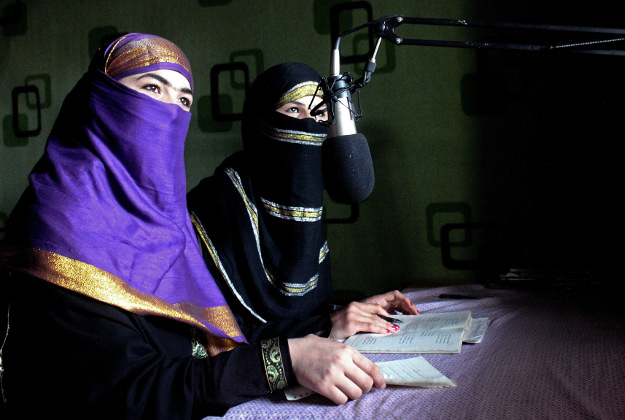 """In this Friday, March 4, 2016 photo, broadcasters of Radio Shaesta prepare themselves to go on-air, in Kunduz, Afghanistan. Radio Shaesta -- Pashto for """"beauty"""" -- had sought to educate women about their rights and address taboo subjects like reproductive health and domestic violence."""