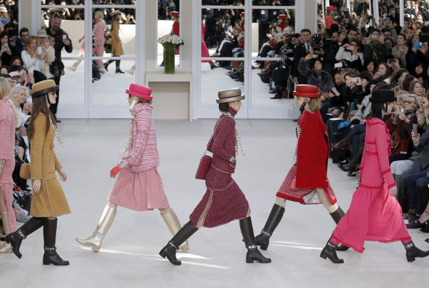 Models wear creations as part of Chanel's Fall-winter 2016-2017 ready to wear collection presented in Paris, France, Tuesday, March 8, 2016.