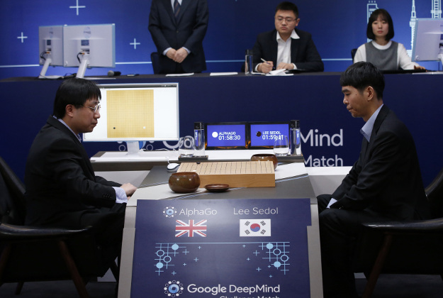 South Korean professional Go player Lee Sedol, right, prepares for his second stone against Google's artificial intelligence program, AlphaGo, as Google DeepMind's lead programmer Aja Huang, left, sits during the Google DeepMind Challenge Match in Seoul, South Korea, Wednesday, March 9, 2016. Google's computer program AlphaGo defeated its human opponent, South Korean Go champion Lee Sedol, on Wednesday in the first game of a historic five-game match between human and computer.